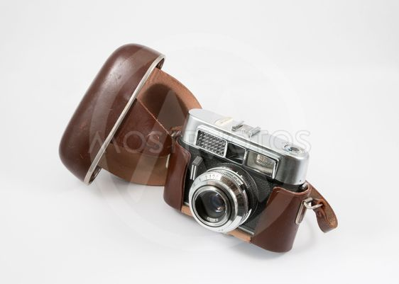 Old camera with open leather case