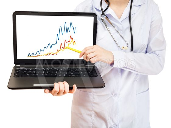 nurse holds computer laptop with charts on screen
