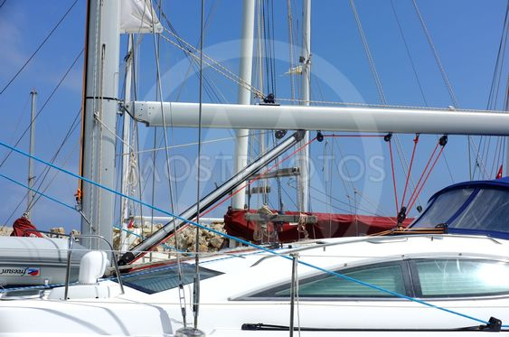Yacht and poles in marina