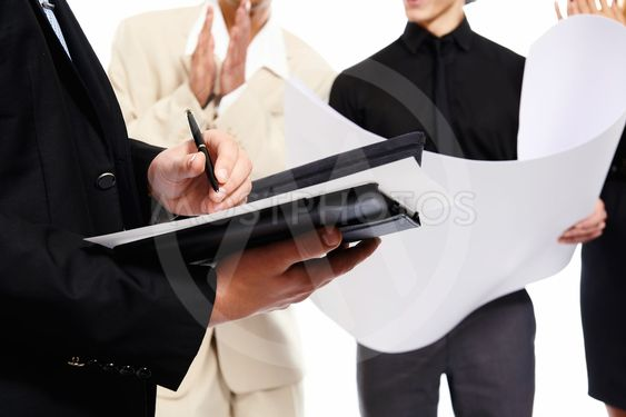 Signing a document. People at business meeting. Studio shot
