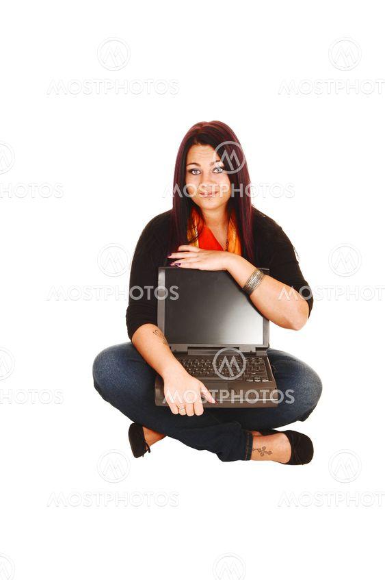 Woman holding laptop.