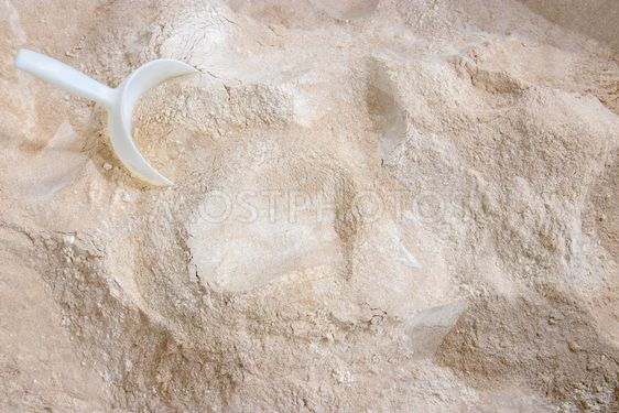Mixed  flour varieties and a plastic shovel seen from above