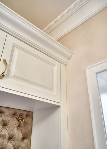 Classic white wardrobe with seating in contemporary...