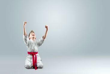 Creative background, a child in a white kimono rejoices...