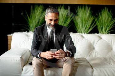 Middle-aged businessman using mobile phone