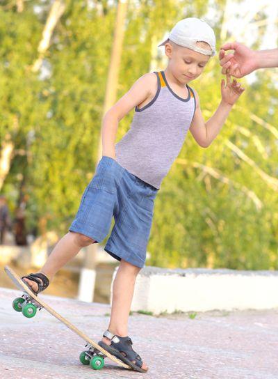 Boy Child Training Skateboard jumping Outdoor Summer...