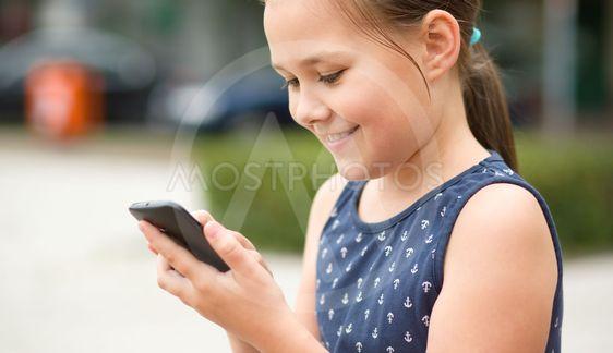 Girl is using smartphone