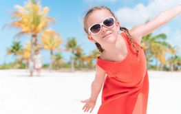 Closeup of adorable little girl during beach vacation...