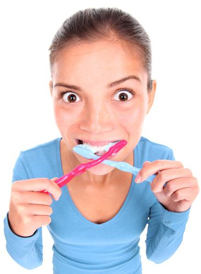 Funny woman toothbrushing