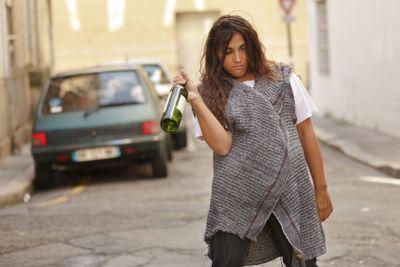 drunk woman walking in street