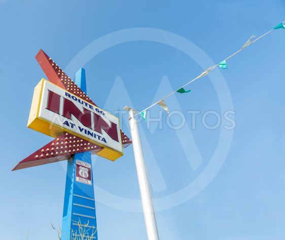 Retro neon arrow shape sign on Route 66, Inn at Vinita,...