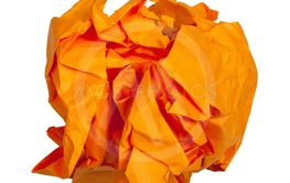 crumpled ball from orange paper isolated