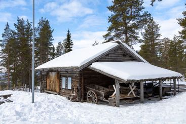 Traditional log house with storage shed