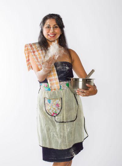Indian Woman Tosses Flour