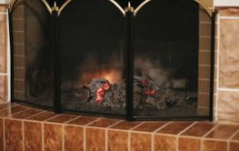 Fire burns in the home fireplace
