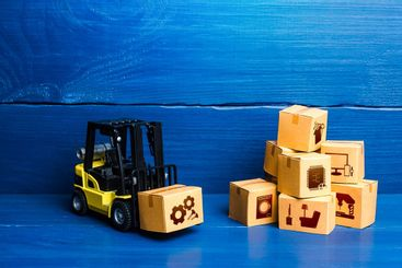 Forklift truck and cardboard boxes with goods. Logistic...