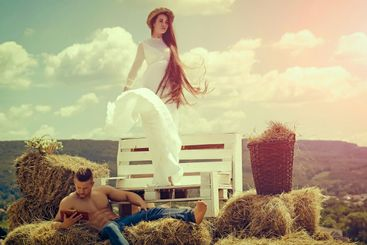 Sensual couple in love relax on village landscape. Woman...