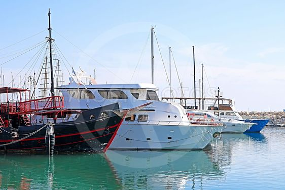 Yachts in Larnaca port, Cyprus. One black boat is...