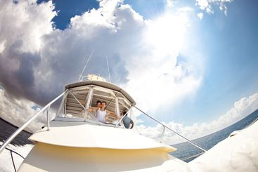 bride and groom in white clothes travel on yacht.