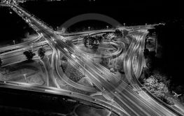 Aerial top view interchange of a city at night,...