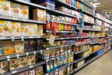 A display of snacks cracker aisle at a Whole Foods...