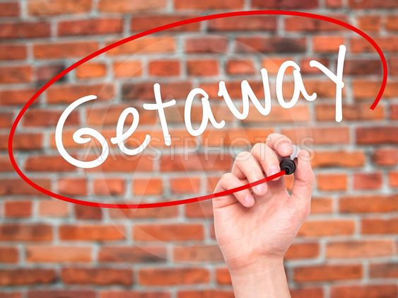 Man Hand writing Getaway with black marker on visual screen