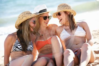 Group Of Teenage Girls Enjoying Beach Holiday Together