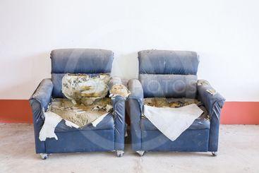 Damaged synthetic leather sofa