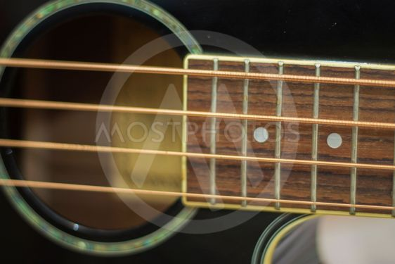 Acoustic bass guitar isolated on the white background