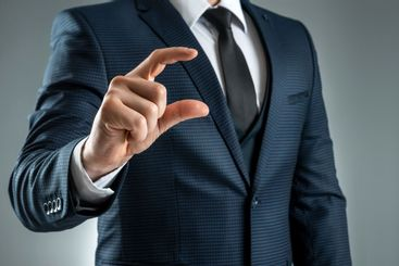 A man in a suit hands close-up shows a virtual business...