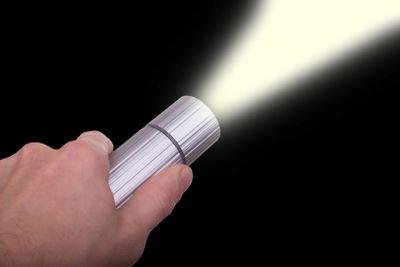 hand holding flashlight