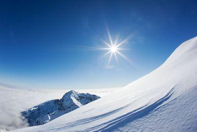 Snowy mountain landscape in a winter clear day.