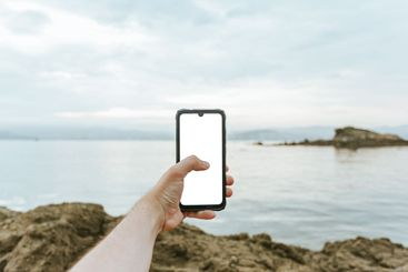 Young male hand grabbing a phone with copy space with...