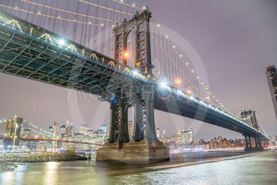 Amazing night view of Manhattan and Brooklyn Bridge at...