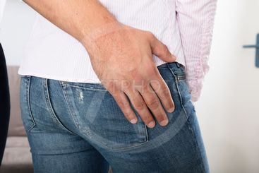 Man Touching Woman's Buttock