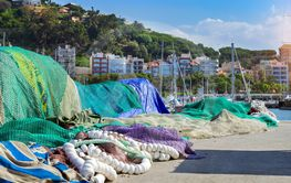 Fishing net with floats drying, port Blanes, Spain
