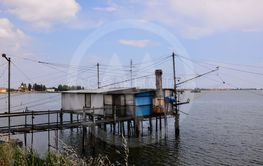 Stilt house and fishing nets along the Po Delta