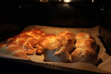 Close-up of bread rolls and baguettes in the oven