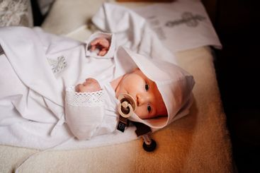 Confirmation. infant baby at the ritual of baptism in...