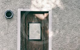 creative mystery retro door on calm street.