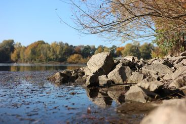 Rocks on the shore of the lake Uetelsheimer See in Germany