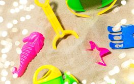 close up of sand toys kit on summer beach