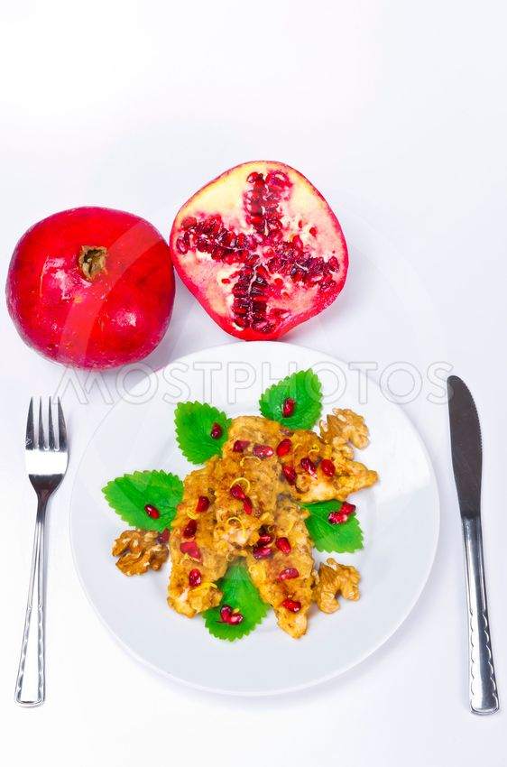 Breaded chicken's breast with pomegranate