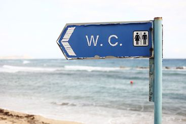 direction to the toilet on the beach. WC - inscription...