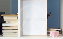 Blank photo frame on bookshelf