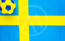 Soccer ball on the background of the national flag of...