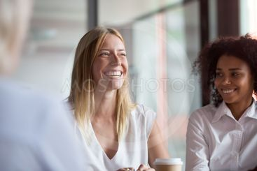 Happy young businesswoman coach mentor leader laughing at...