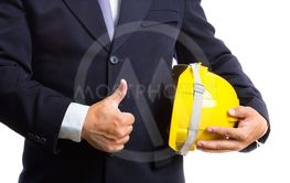 engineer holding helmet on white background