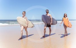 Boys and girls teen surfers with surfboards