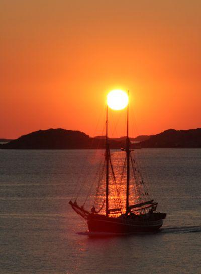 Sun over boat